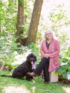 Diane Mader outside with her dog